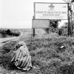 Engeye Clinic sign with person by the road